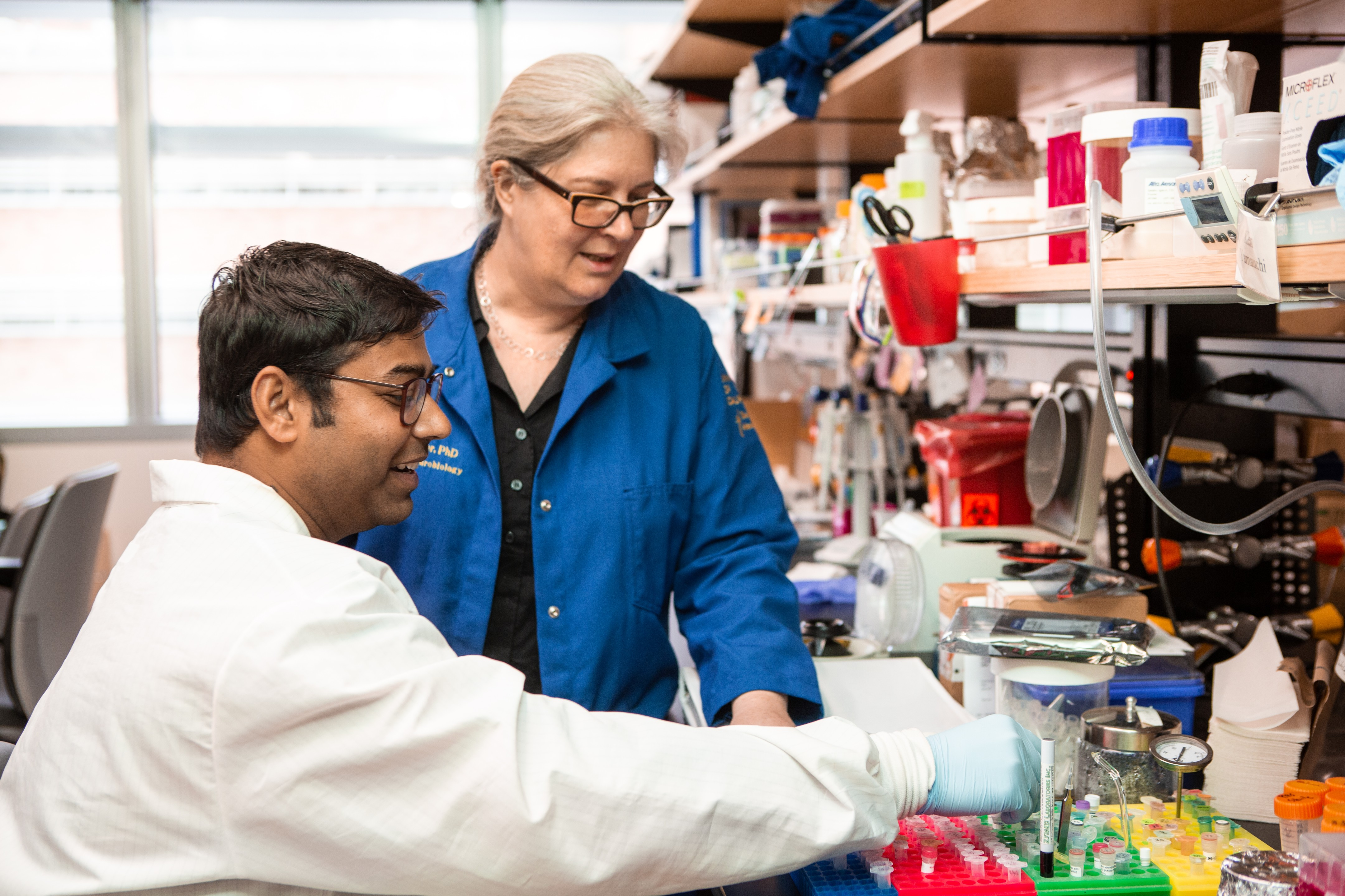 Image of one male researcher and one female researcher in a lab