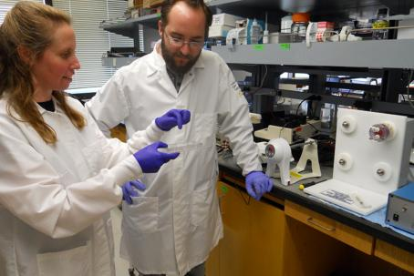 Image of Dr. Brigitte Gomperts and Dan Wilkinson in the lab